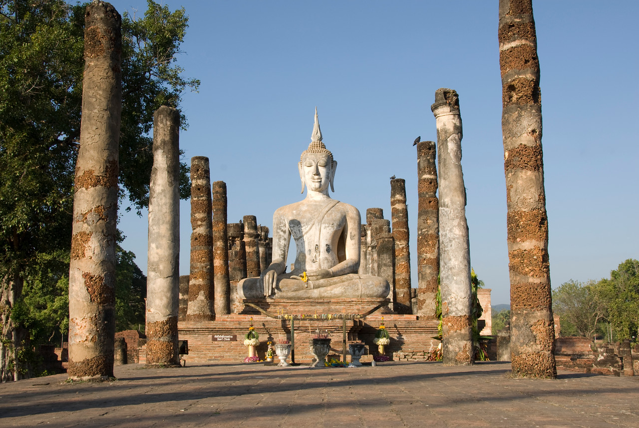 Big Buddha statue sitting in the middle of Wat Mahathat ruins - Sukhothai, Thailand