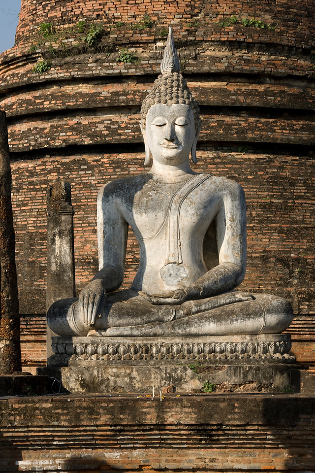 Isolated shot of Buddha statue in Wat Sa Si - Sukhothai, Thailand