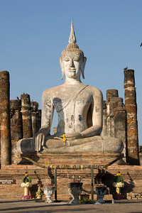 Sitting Buddha statue in the middle of Wat Mahathat ruins - Sukhothai, Thailand