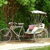 A bicycle rickshaw, iconic to Chiang Mai, found resting at a wat (temple) in Chiang Mai, Thailand.