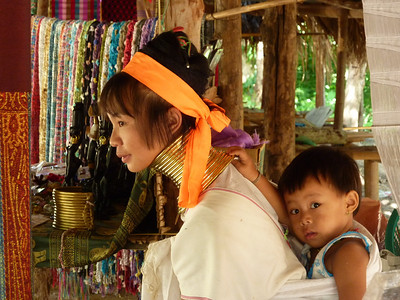 The Long Neck Karen tribe are indeginous to Burma and Northern Thailand.  A mother and child found outside of Chiang Mai.