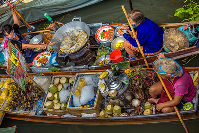 Local sellers at a floating market in Thailand