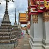 Two stone guardians at Wat Po, one of the largest and oldest wats (temples) in Thailand.