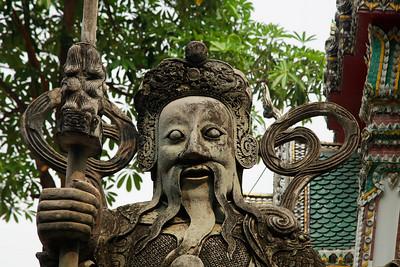 Bangkok, Thailand Chinese statues guard the temple gates at Wat Pho.