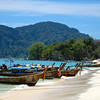 Traditional Thai long tail boats at rest at Phi Phi Island.