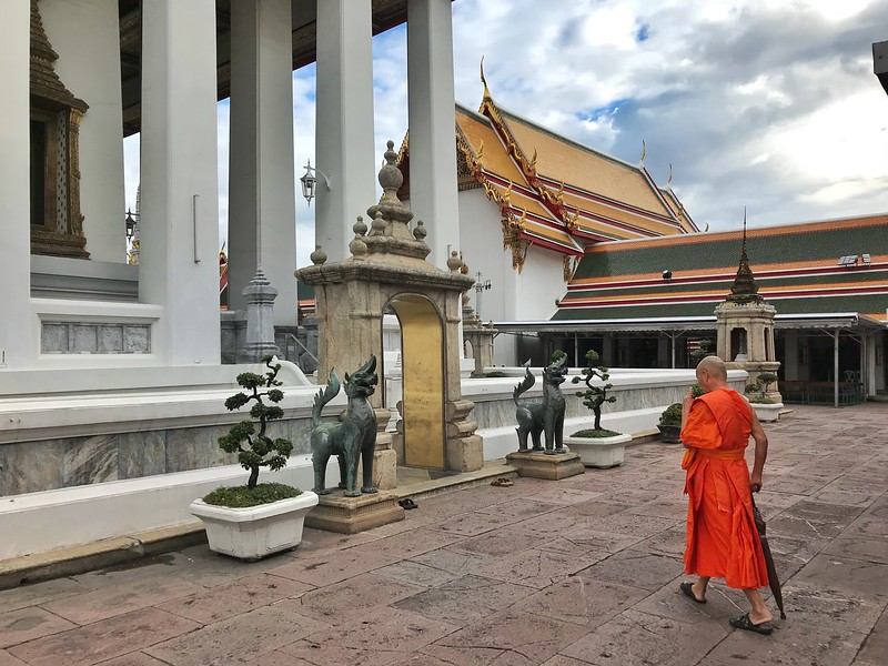 A Buddhist monk at Wat Pho temple in Bangkok, Thailand