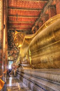The Reclining Buddha  at Wat Pho Created as part of Rama III's restoration (1824-51), it is 150 feet long and 50 feet high. - Bangkok