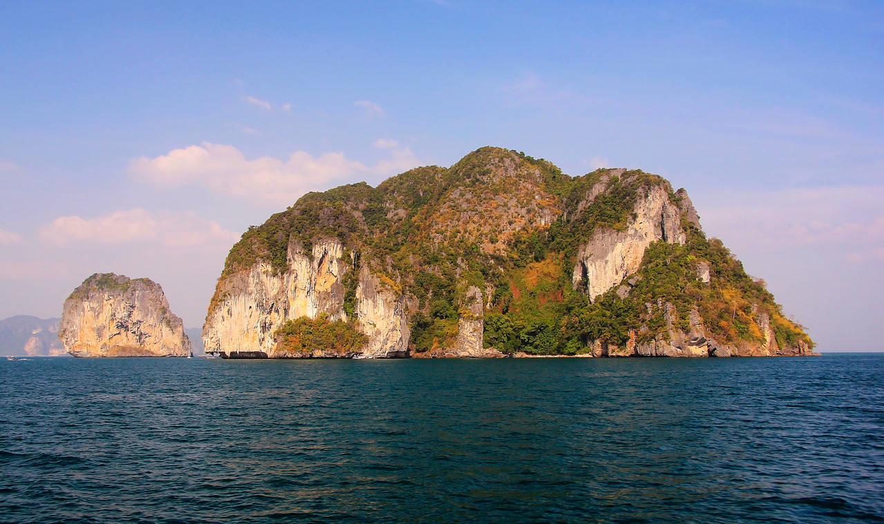 The afternoon sun setting on the remarkable cliffs jutting out of the Andaman Sea