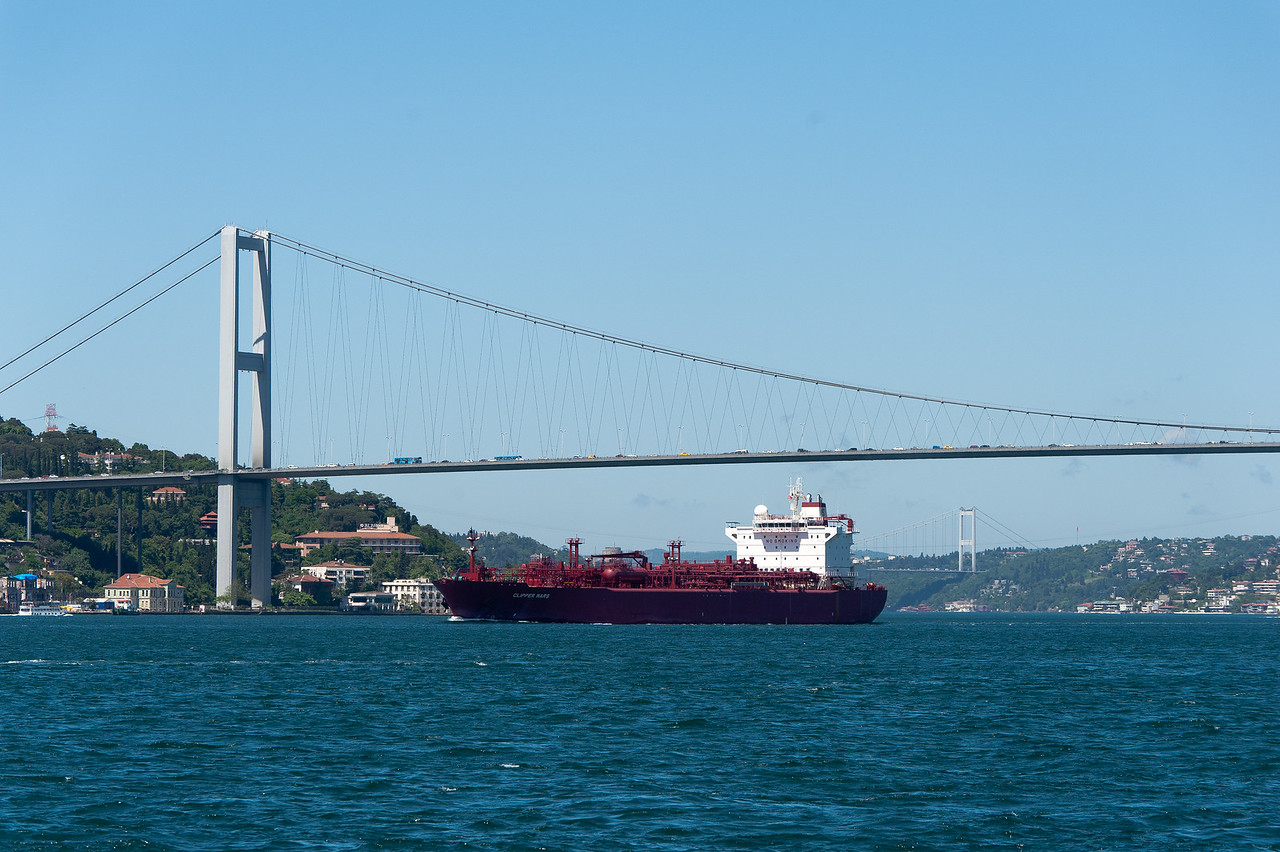 Boat cruising next to the bridge in Istanbul, Turkey