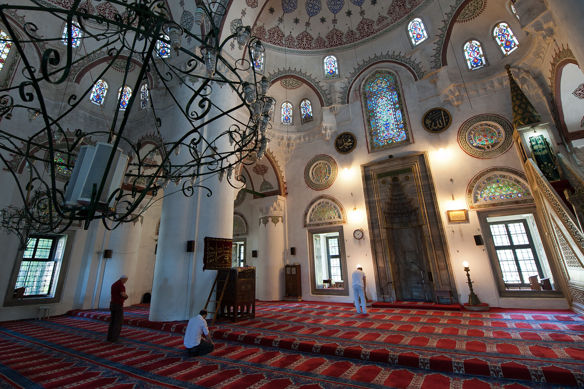 Men saying prayers in a local mosque in Istanbul, Turkey