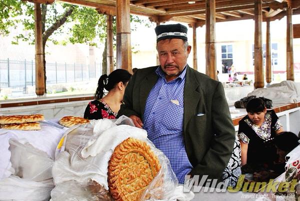 A vendor showing off his nan