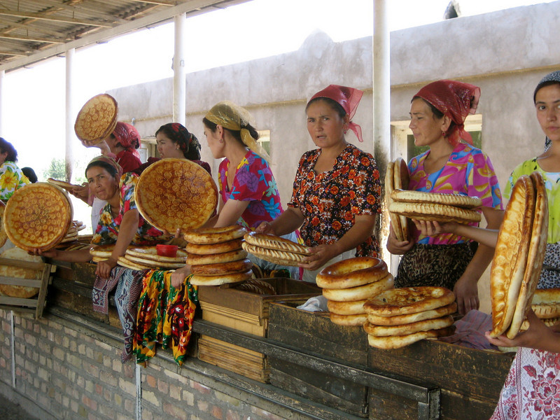 Uzbek women touting their day's product along the road in the Ferghana Valley.