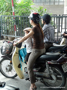 Kids share the driving duties with their parents on Hanoi motorbikes