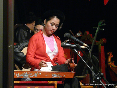 A theatre musician plays a haunting piece on an ancient, mysterious instrument. Her poise and quiet presence stood out, as it does with most Vietnamese.