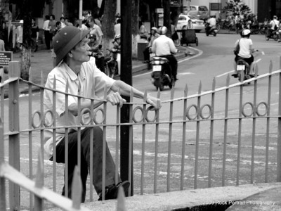 Escaping Hanoi? Stretching leg muscles? Testing the strength of the fence? Or simply reminiscing about the old days? You decide.
