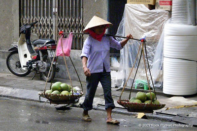 A dark, wet morning, but work never stops on Hanoi streets. In fact it starts around 5am!