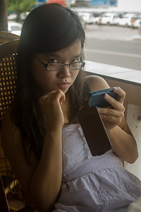 Quynh is disturbed from her game-playing.
