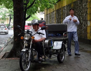 Motorised cyclo outside the Hanoi Hilton