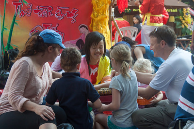 A family joins in with a traditional Tet game.