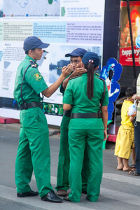 These tourist police appear to be discussing where one should karate chop another when looking for maximum results with minimum effort.