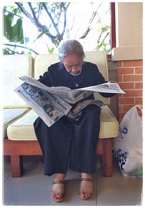 Grandma catches up with the news while waiting for us to check out