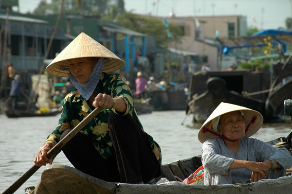 Rowing under the Sun - Mekong Delta, Vietnam