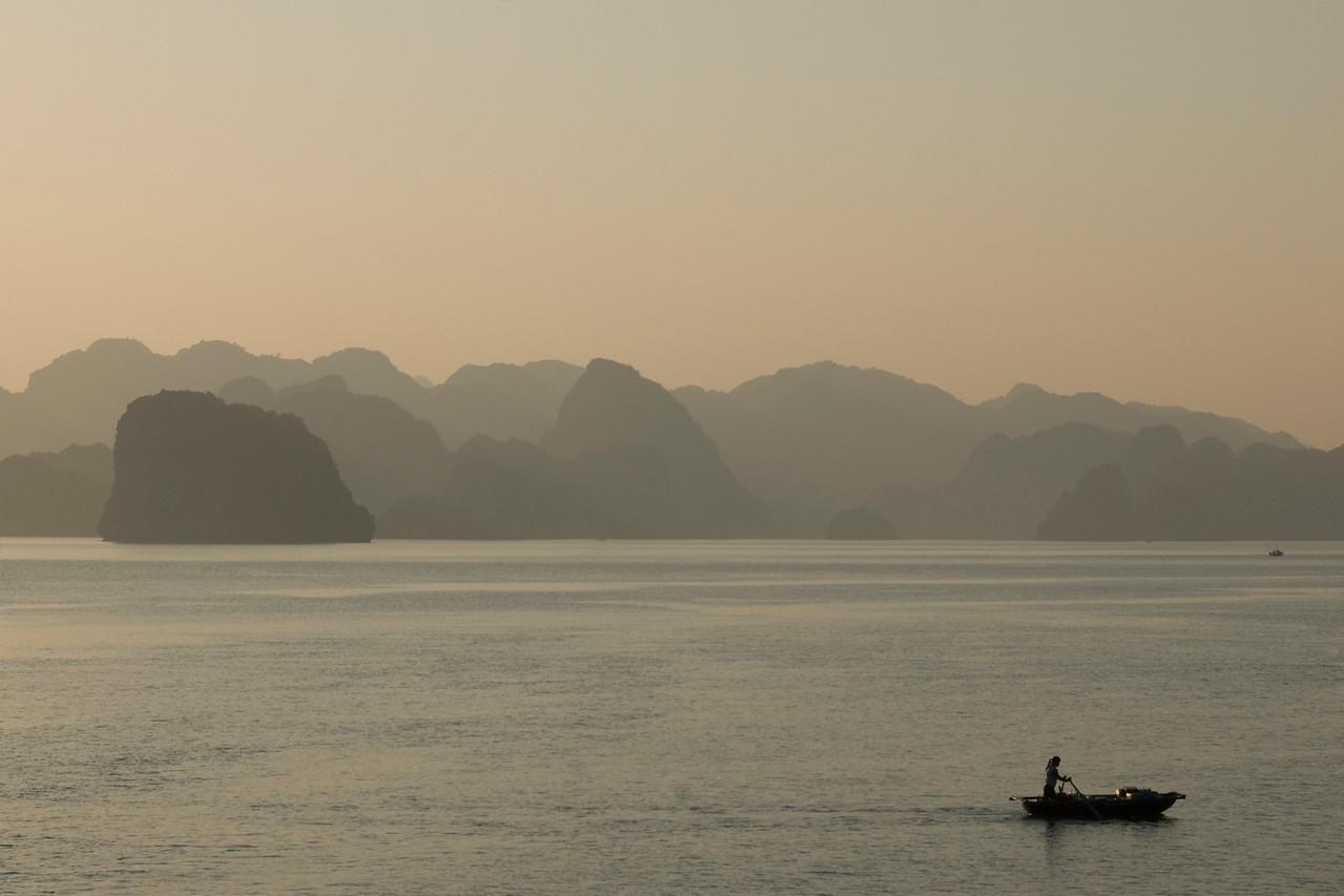 Woman in Boat at Sunset - Ha Long Bay, Vietnam