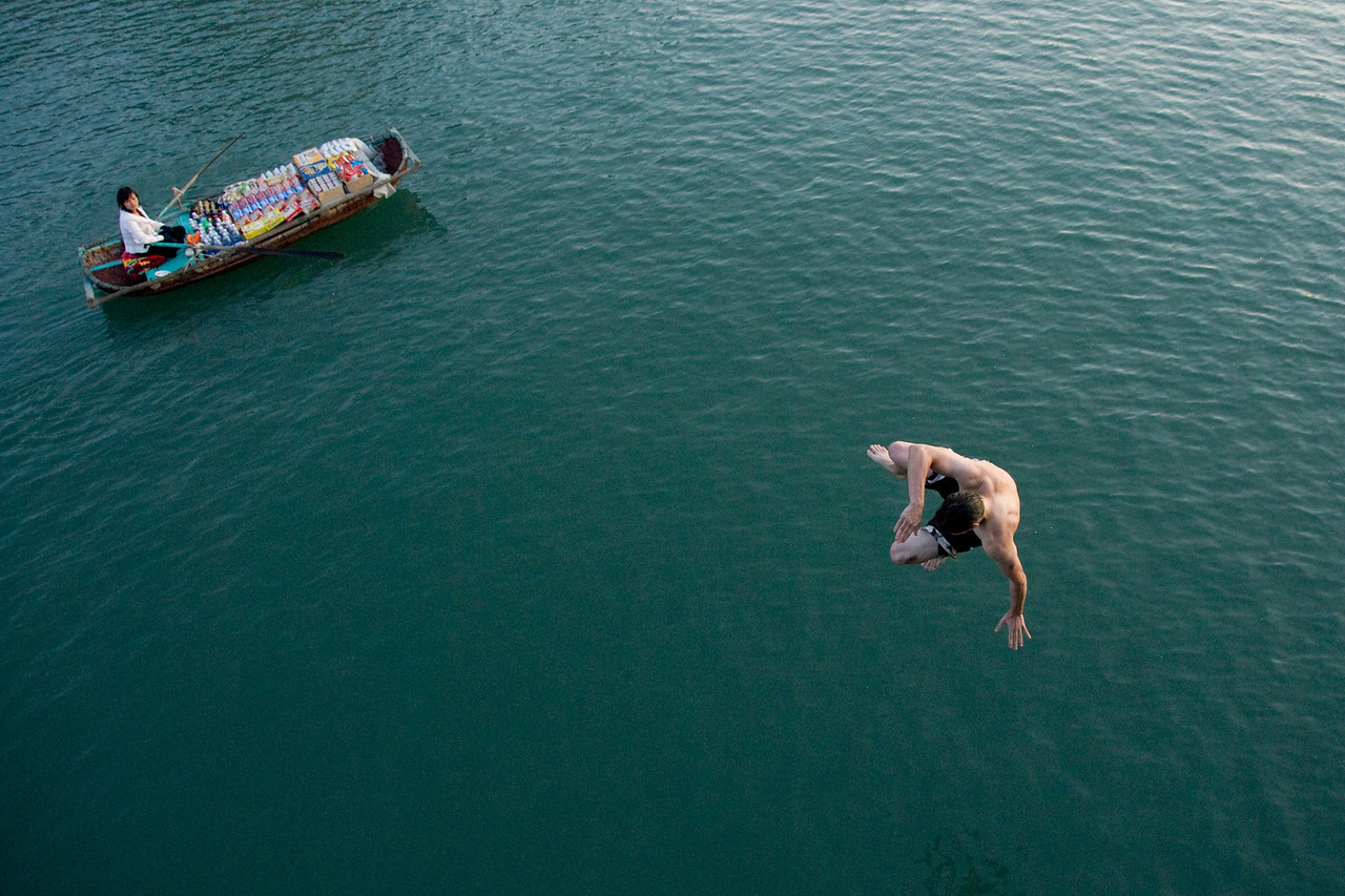 Man jumping off the boat in Ha Long Bay, Vietnam