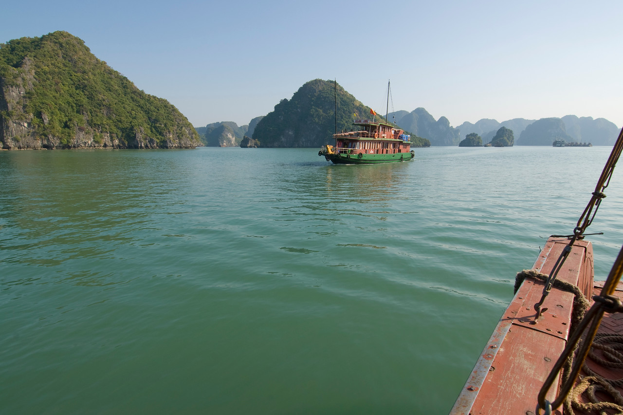 Boats cruising the water in Ha Long Bay, Vietnam