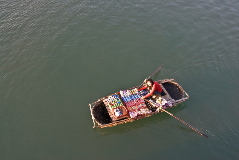 Woman selling snacks on a boat - Ha Long Bay, Vietnam
