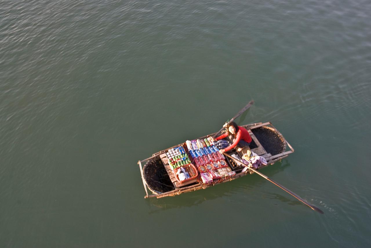 Woman selling snacks on a boat - Ha Long Bay, Vietnam