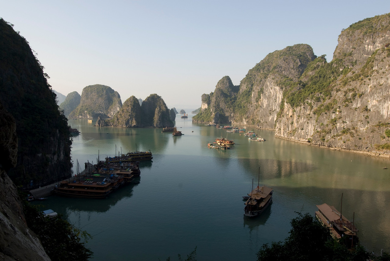 Boats parked outside Cave Harbor in Ha Long Bay, Vietnam