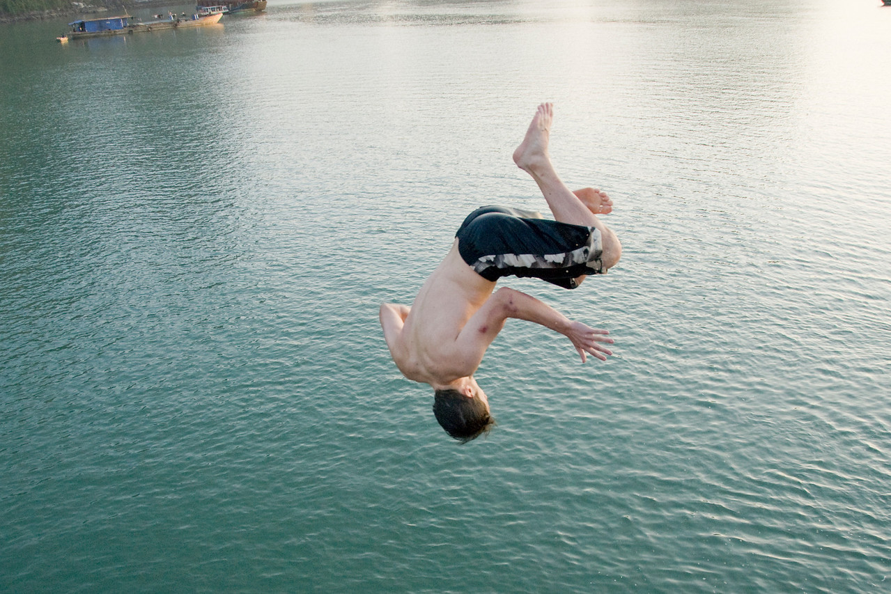 Man back flipping into the water - Ha Long Bay, Vietnam