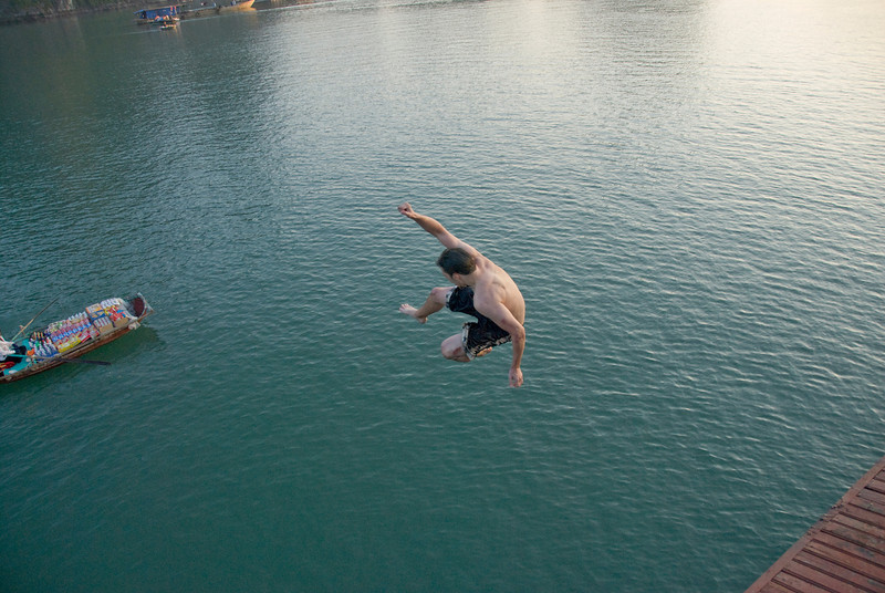 Man in mid-air after jumping off the boat - Ha Long Bay, Vietnam