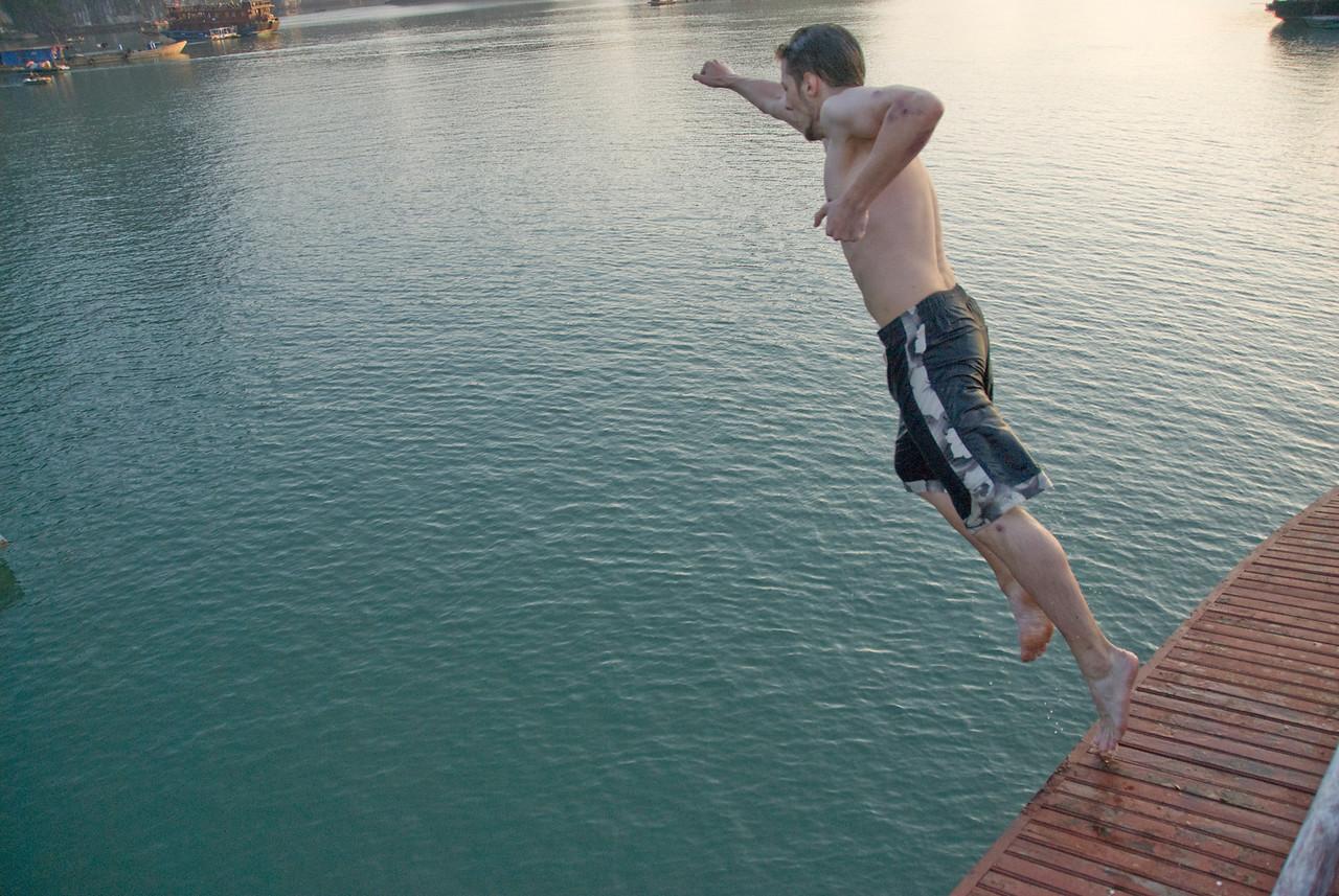 Man dives off the boat - Ha Long Bay, Vietnam