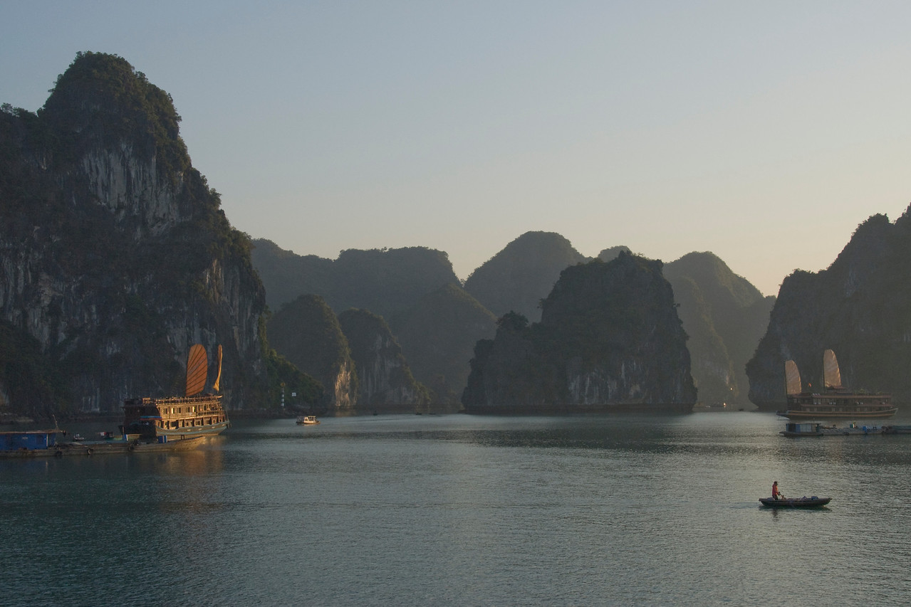 Tourist boat cruising the Ha Long Bay at sunset - Vietnam