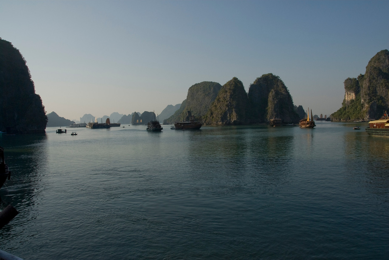 Boats exploring the islands of Ha Long Bay, Vietnam