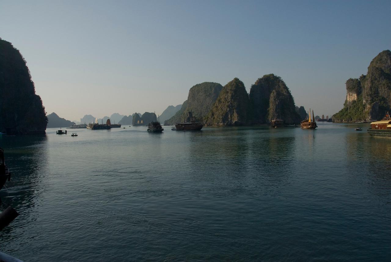 Boats exploring the islands of Ha Long Bay, Vietnam