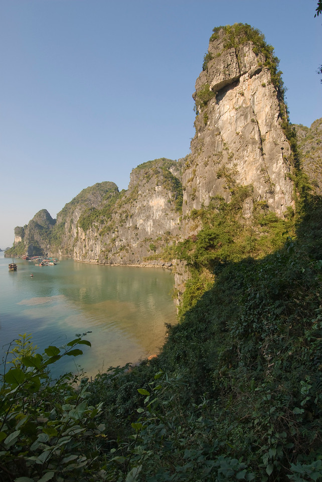 Steep cliffs and rock formation outside the cave harbor - Ha Long Bay, Vietnam