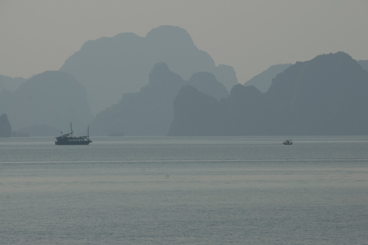 Misty shot of boats and islands- Ha Long Bay, Vietnam