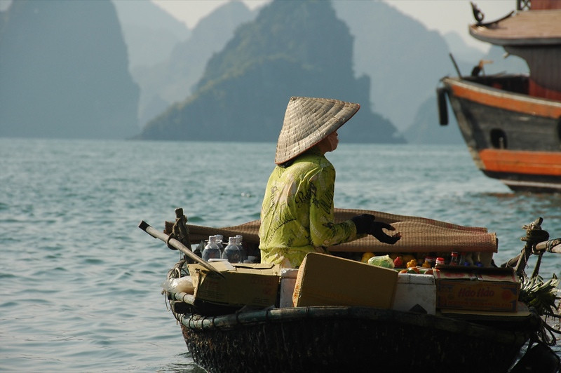 Woman Selling in a Rowboat - Halong Bay, Vietnam