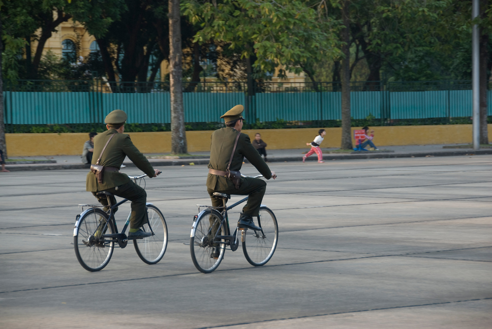 Soldiers riding bicycles in Hanoi, Vietnam