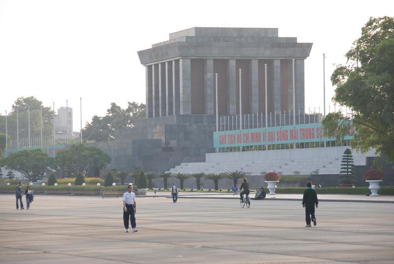 Locals taking leisurely walk in Ho Chi Minh Square - Hanoi, Vietnam
