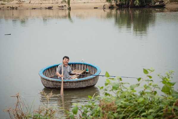 Smiles from an local Vietnamese man in a boat