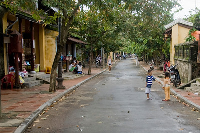 Locals spotted on a street in Hoi An, Vietnam