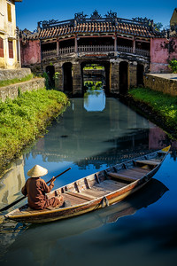 Enchanting Hoi An with its iconic Japanese Bridge (Chua Cau) blessed by the magic morning lightning.