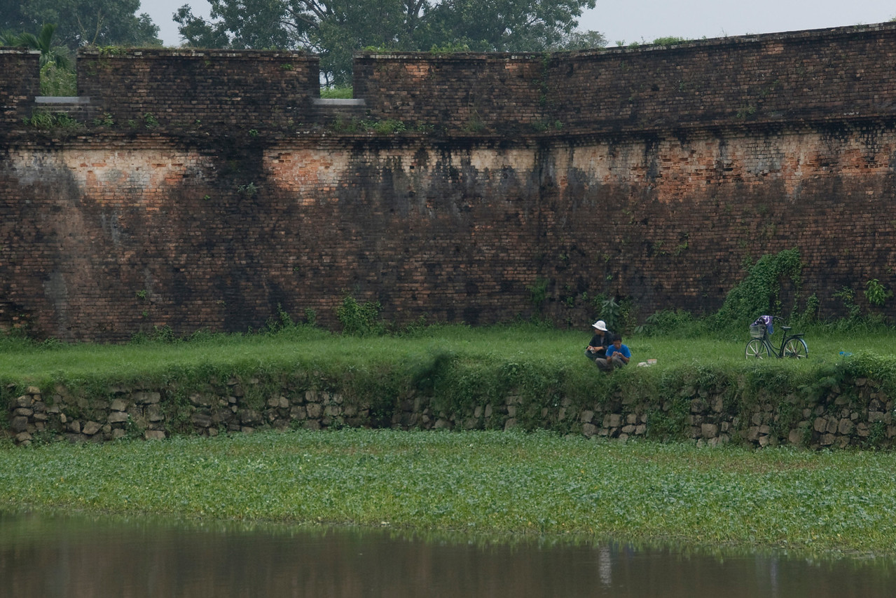 Men fishing at moat in Citadel - Hue, Vietnam