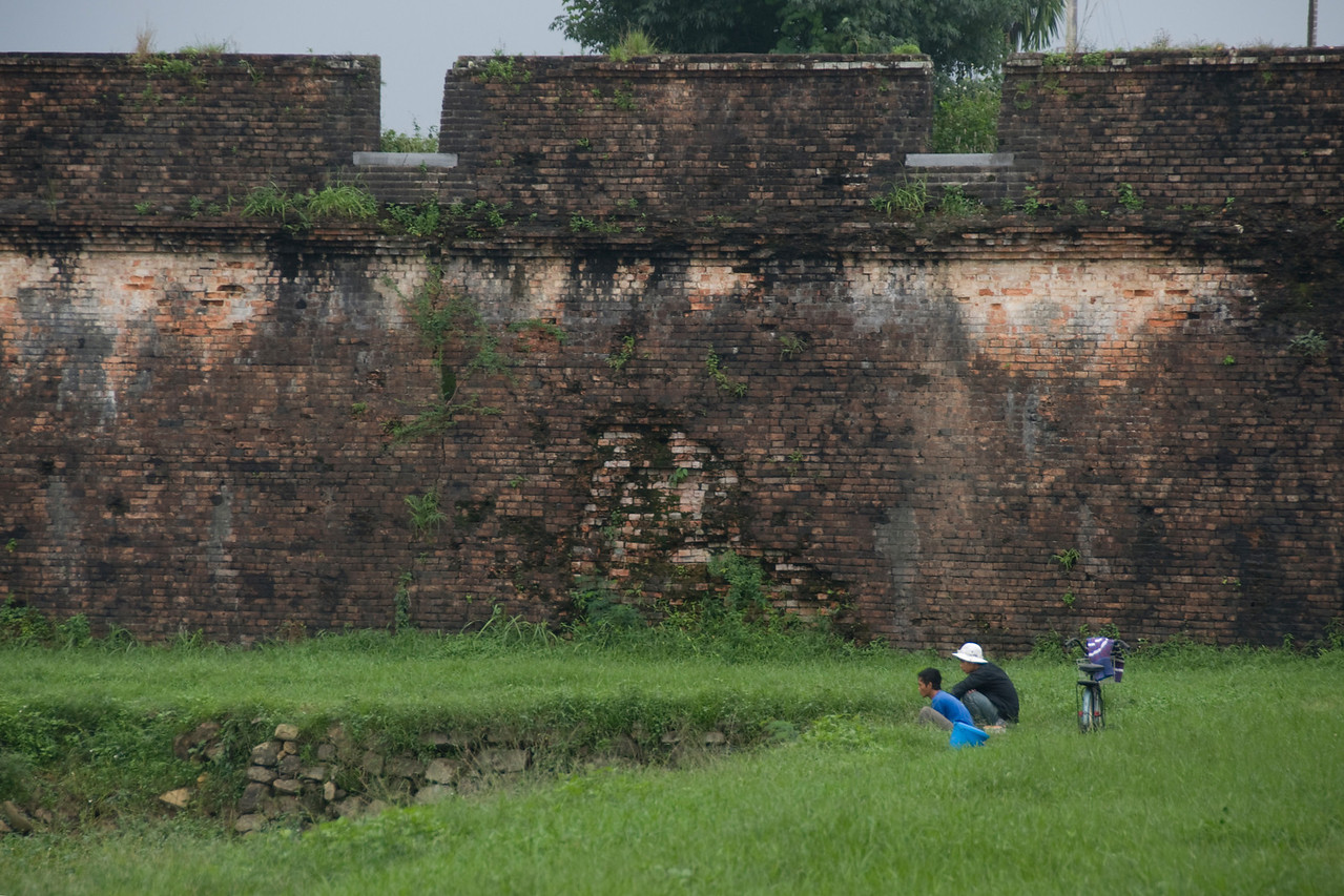 Men fishing near the wall of Citadel - Hue, Vietnam