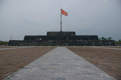 National flag over walled fortress in Citadel - Hue, Vietnam