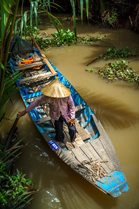 Woman at work at the Mekong Delta.